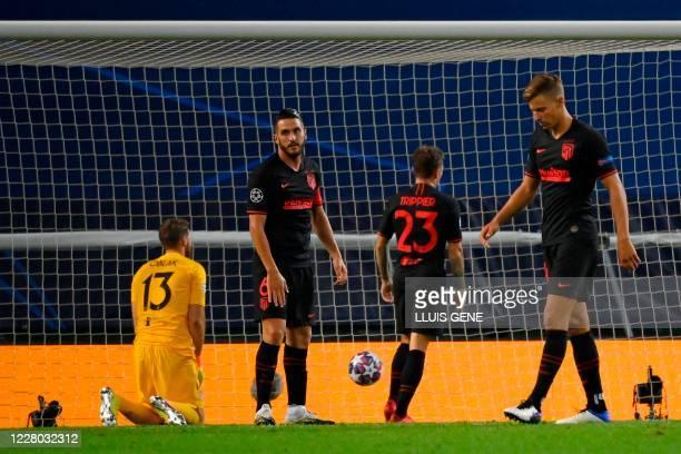 Atletico Madrid's Spanish midfielder Koke and teammates react to Leipzig's Spanish midfielder Dani Olmo's goal during the UEFA Champions League...
