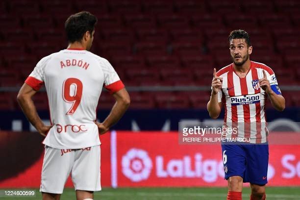 Atletico Madrid's Spanish midfielder Koke celebrates after scoring a goal during the Spanish League football match between Atletico Madrid and...