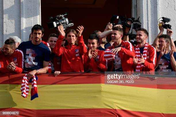 Atletico Madrid's Spanish midfielder Koke Croatian defender Sime Vrsaljko French forward Kevin Gameiro Brazilian defender Filipe Luis Argentinian...
