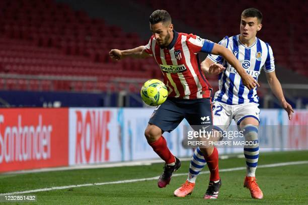 Atletico Madrid's Spanish midfielder Koke vies with Real Sociedad's Spanish forward Ander Barrenetxea during the Spanish league football match Club...