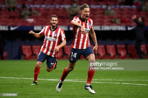 Atletico Madrid's Spanish midfielder Marcos Llorente celebrates after scoring a goal during the Spanish League football match between Atletico Madrid...