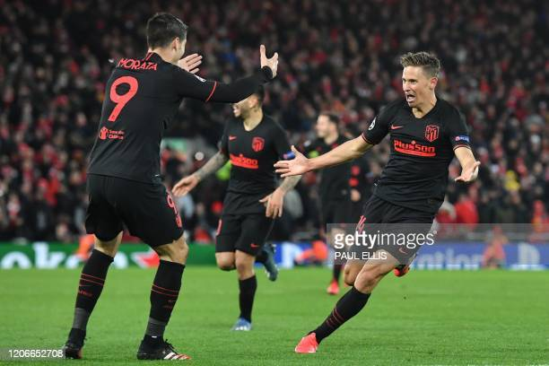 TOPSHOT Atletico Madrid's Spanish midfielder Marcos Llorente celebrates scoring his team's second goal during the UEFA Champions league Round of 16...