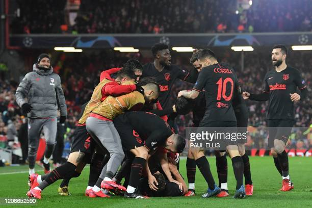 Atletico Madrid's Spanish midfielder Marcos Llorente celebrates with teammates after he scores his team's first goal during the UEFA Champions league...
