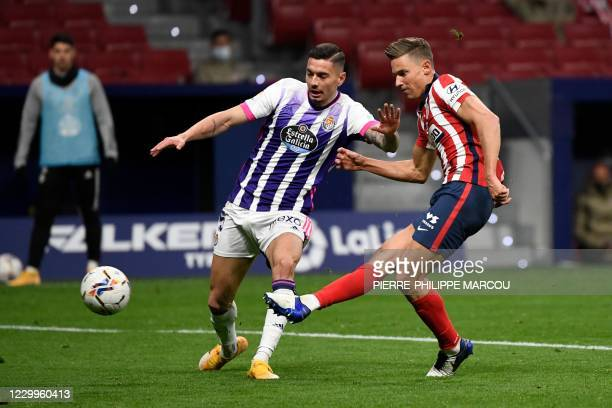 Atletico Madrid's Spanish midfielder Marcos Llorente scores a goal during the Spanish League football match between Atletico Madrid and Real...