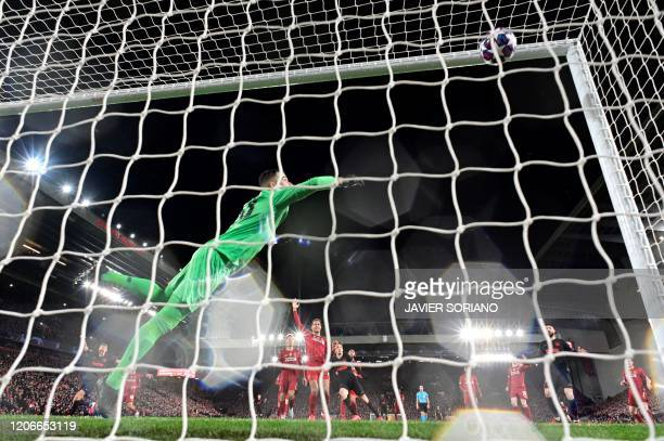 Atletico Madrid's Spanish midfielder Marcos Llorente scores his team's first goal during the UEFA Champions league Round of 16 second leg football...