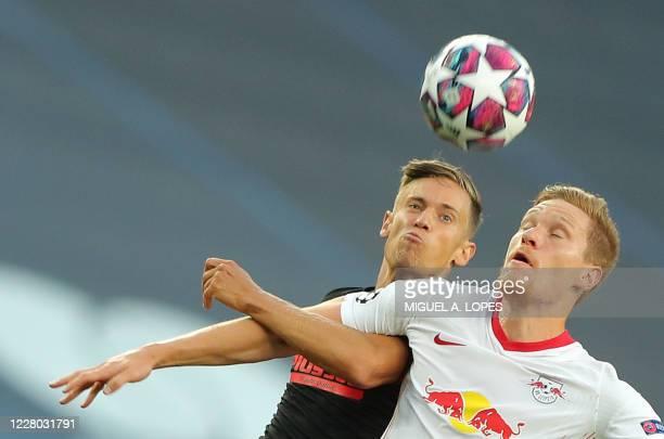 Atletico Madrid's Spanish midfielder Marcos Llorente vies with Leipzig's German defender Marcel Halstenberg during the UEFA Champions League...