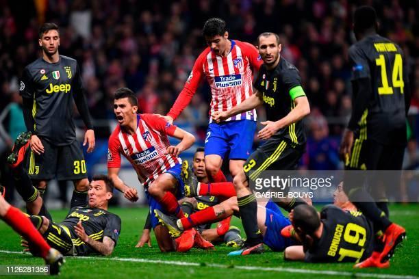 Atletico Madrid's Spanish midfielder Rodri and Atletico Madrid's Spanish forward Alvaro Morata react as Atletico Madrid's Uruguayan defender Jose...
