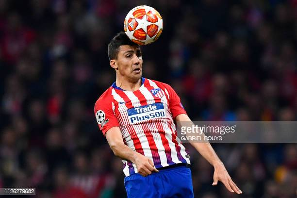 Atletico Madrid's Spanish midfielder Rodri heads the ball during the UEFA Champions League round of 16 first leg football match between Club Atletico...