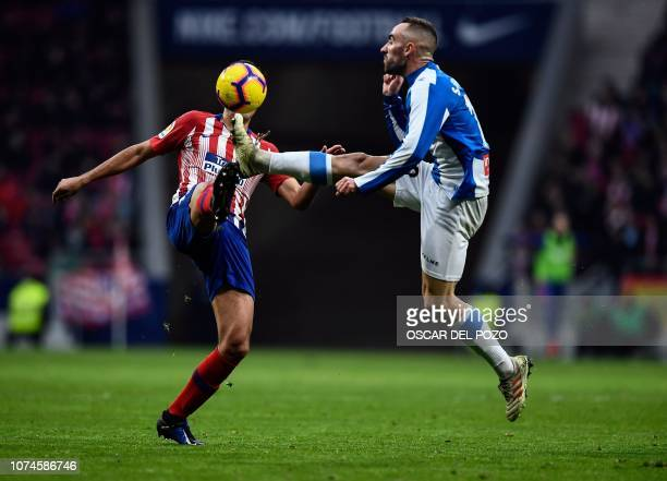 Atletico Madrid's Spanish midfielder Rodri vies with Espanyol's midfielder Didac Vila during the Spanish League football match between Club Atletico...