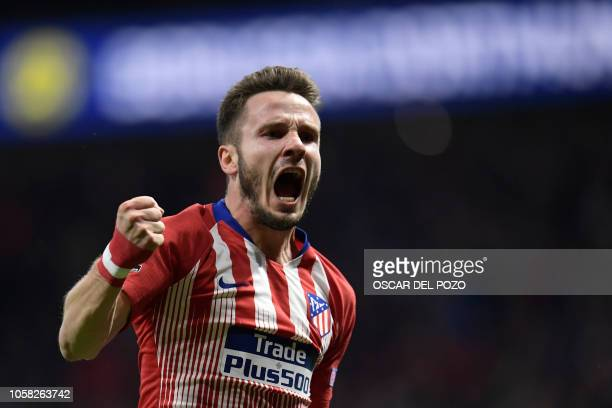 Atletico Madrid's Spanish midfielder Saul Niguez celebrates a goal during the UEFA Champions League group A football match between Club Atletico de...