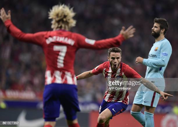 TOPSHOT Atletico Madrid's Spanish midfielder Saul Niguez celebrates a goal during the Spanish league football match Club Atletico de Madrid vs FC...