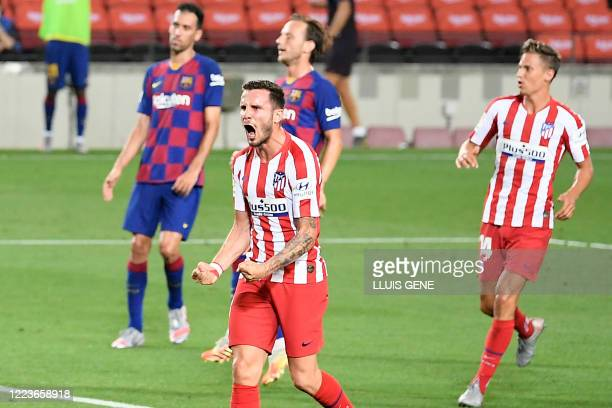 Atletico Madrid's Spanish midfielder Saul Niguez celebrates after scoring a second penalty during the Spanish League football match between FC...
