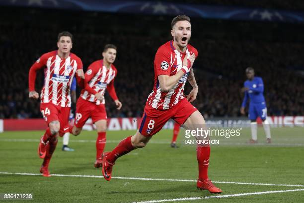TOPSHOT Atletico Madrid's Spanish midfielder Saul Niguez celebrates after scoring during a UEFA Champions League Group C football match between...