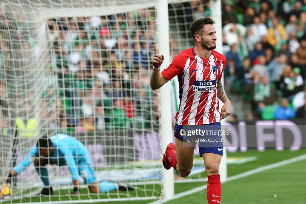Atletico Madrid's Spanish midfielder Saul Niguez celebrates after scoring a goal during the Spanish league football match between Real Betis and Atletico Madrid at the Benito Villamarin Stadium in Sevilla on December 10, 2017. /