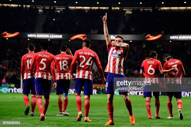 Atletico Madrid's Spanish midfielder Saul Niguez celebrates after scoring during the Europa League Round of 16 first leg football match between Club...