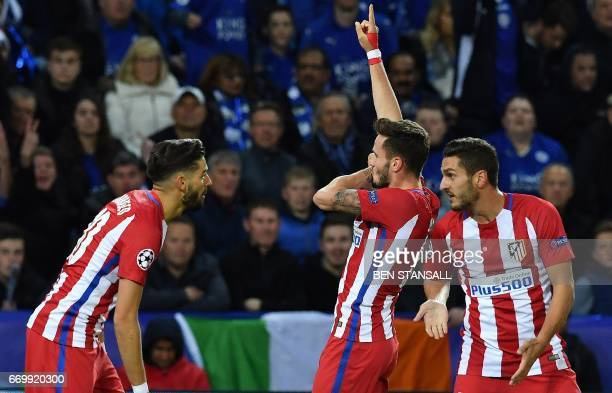 Atletico Madrid's Spanish midfielder Saul Niguez celebrates scoring his team's first goal during the UEFA Champions League quarterfinal second leg...