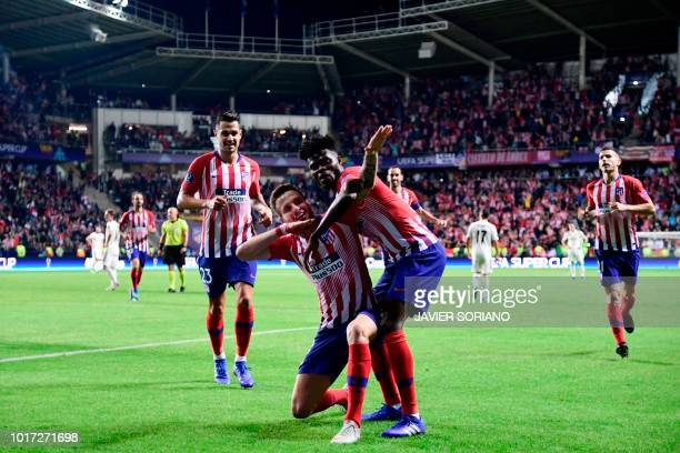 Atletico Madrid's Spanish midfielder Saul Niguez celebrates with teammates after scoring a goal during the UEFA Super Cup football match between Real...