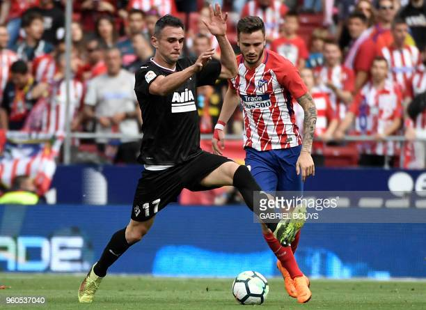 Atletico Madrid's Spanish midfielder Saul Niguez challenges Eibar's Spanish forward Kike during the Spanish league football match between Club...