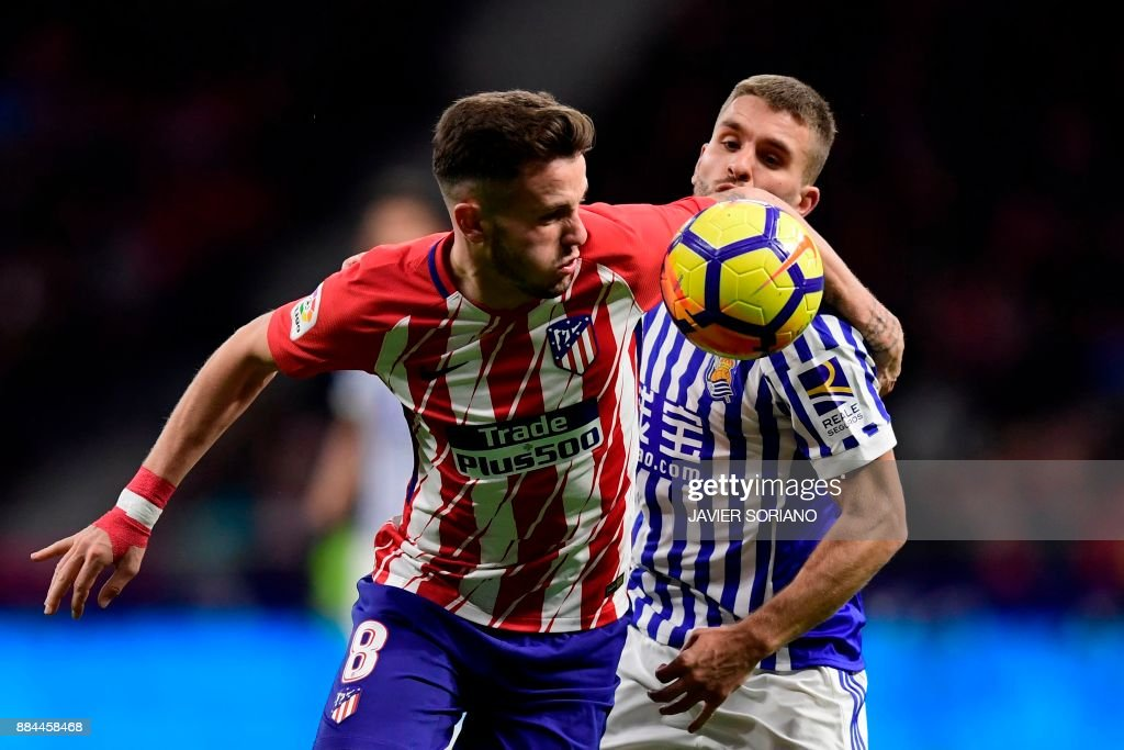 Atletico Madrid's Spanish midfielder Saul Niguez (L) challenges Real Sociedad's Portuguese midfielder Kevin Rodrigues during the Spanish league football match Club Atletico de Madrid vs Real Sociedad at the Wanda Metropolitano stadium in Madrid on December 2, 2017. /