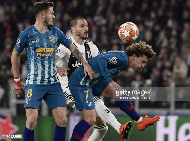 Atletico Madrid's Spanish midfielder Saul Niguez Juventus' Italian defender Leonardo Bonucci and Atletico Madrid's French forward Antoine Griezmann...