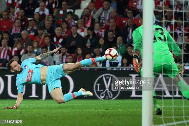 Atletico Madrid's Spanish midfielder Saul Niguez kicks the ball during the Spanish league football match between Athletic Club Bilbao and Club...