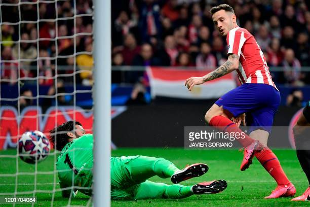 Atletico Madrid's Spanish midfielder Saul Niguez scores the opening goal during the UEFA Champions League, round of 16, first leg football match...
