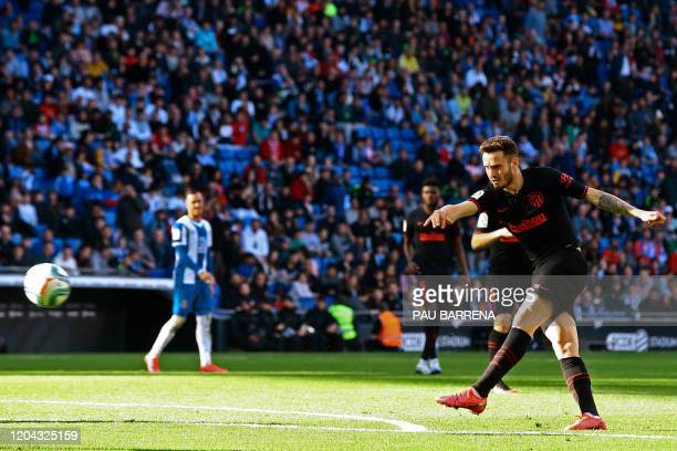 Atletico Madrid's Spanish midfielder Saul Niguez shoots to score a goal during the Spanish League football match between Espanyol and Atletico Madrid...
