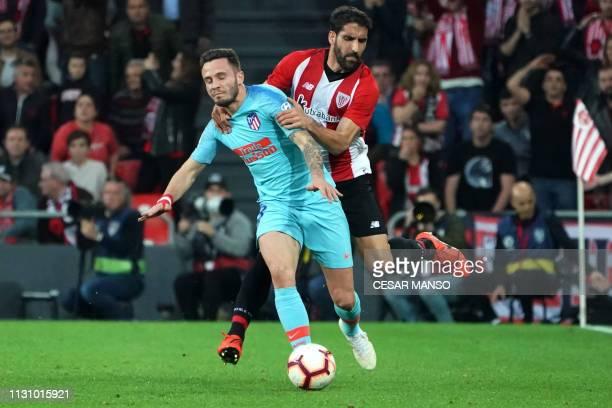Atletico Madrid's Spanish midfielder Saul Niguez vies with Athletic Bilbao's Spanish midfielder Raul Garcia during the Spanish league football match...