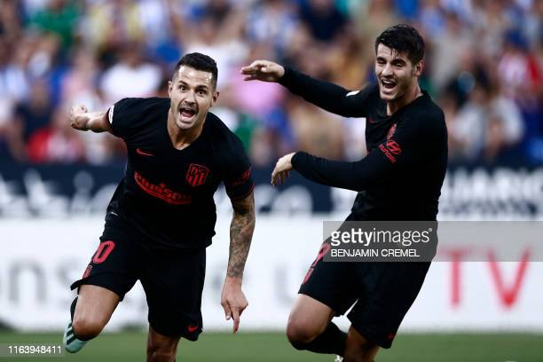 Atletico Madrid's Spanish midfielder Vitolo celebrates with Atletico Madrid's Spanish forward Alvaro Morata after scoring a goal during the Spanish...