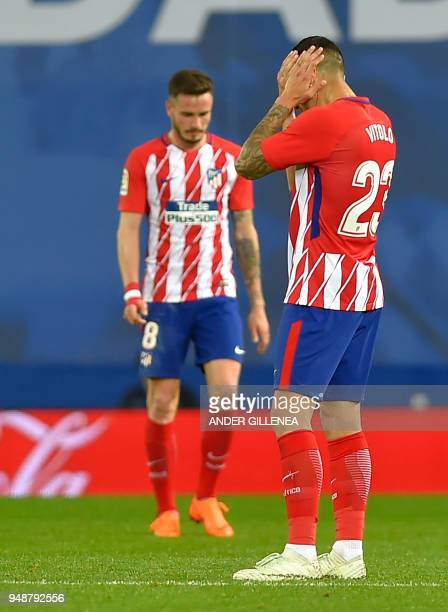 Atletico Madrid's Spanish midfielder Vitolo gestures following Real Sociedad's second goal during the Spanish league football between Real Sociedad...