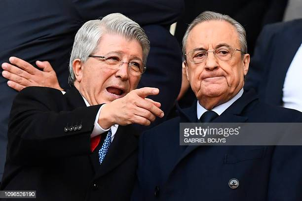 Atletico Madrid's Spanish president Enrique Cerezo speaks to Real Madrid's Spanish president Florentino Perez before the Spanish league football...