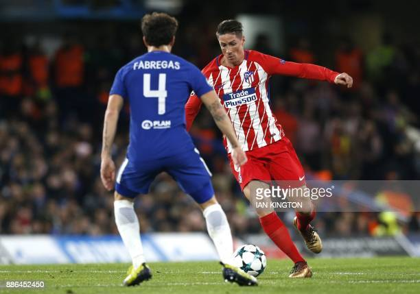 Atletico Madrid's Spanish striker Fernando Torres vies with Chelsea's Spanish midfielder Cesc Fabregas during a UEFA Champions League Group C...
