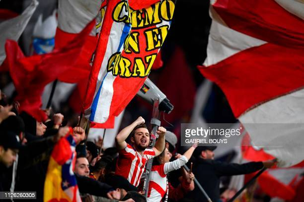 Atletico Madrid's supporters cheer before the UEFA Champions League round of 16 first leg football match between Club Atletico de Madrid and Juventus...