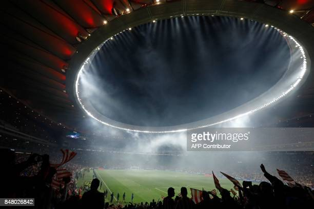 Atletico Madrid's supporters cheer during the inauguration of the Wanda Metropolitano stadium after the Spanish league football match Club Atletico...