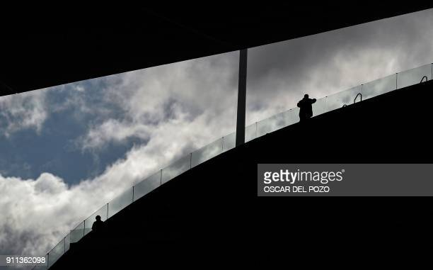 TOPSHOT Atletico Madrid's supporters wait before Spanish league football match between Club Atletico de Madrid and UD Las Palmas at the Wanda...