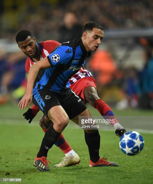 Atletico Madrid's Thomas Lemar vies with Bruges Sofyan Amrabat during the UEFA Champions League football match between Club Brugge and Atletico...