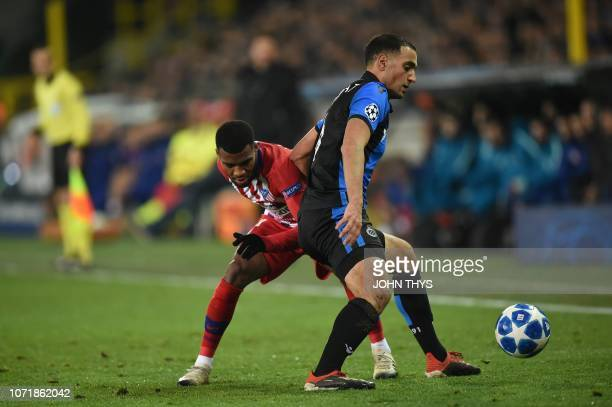 Atletico Madrid's Thomas Lemar vies with Bruges' Sofyan Amrabat during the UEFA Champions League football match between Club Brugge and Atletico...