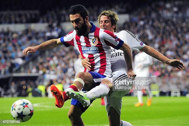 Atletico Madrid's Turkish midfielder Arda Turan vies with portuguese defender Fabio Coentrao during the UEFA Champions League quarterfinals second...