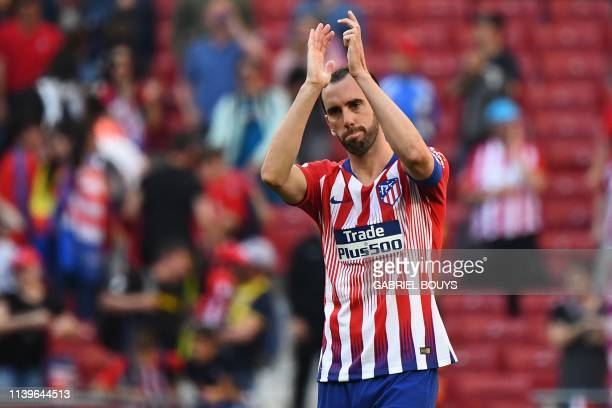 Atletico Madrid's Uruguayan defender Diego Godin acknowledges fans at the end of the Spanish League football match between Atletico Madrid and Real...