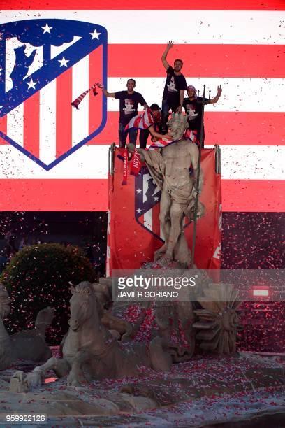 Atletico Madrid's Uruguayan defender Diego Godin Atletico Madrid's Spanish forward Fernando Torres Atletico Madrid's Spanish midfielder Gabi and...