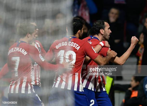 Atletico Madrid's Uruguayan defender Diego Godin celebrates a goal during the Spanish league football match between Club Atletico de Madrid and Real...