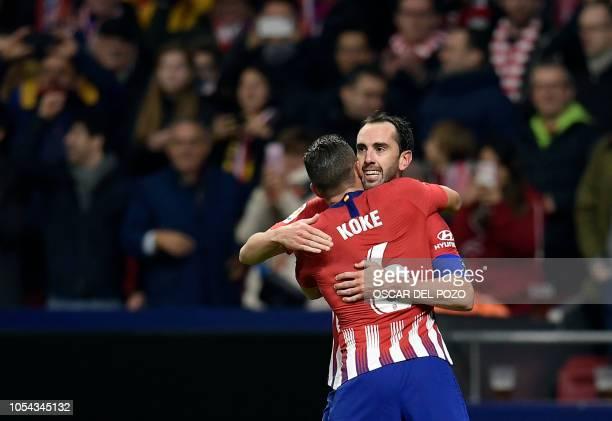 Atletico Madrid's Uruguayan defender Diego Godin celebrates a goal with Atletico Madrid's Spanish midfielder Koke during the Spanish league football...