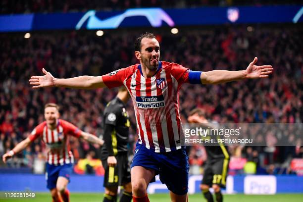 Atletico Madrid's Uruguayan defender Diego Godin celebrates after scoring his team's second goal during the UEFA Champions League round of 16 first...