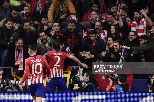 Atletico Madrid's Uruguayan defender Diego Godin celebrates his goal with fans during the UEFA Champions League round of 16 first leg football match...