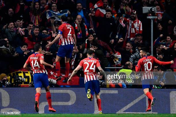 Atletico Madrid's Uruguayan defender Diego Godin celebrates with teammates after scoring his team's second goal during the UEFA Champions League...