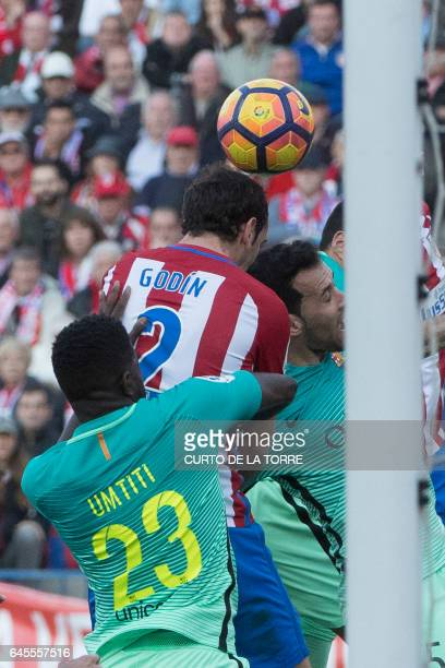 Atletico Madrid's Uruguayan defender Diego Godin heads the ball to score a goal during the Spanish league football match Club Atletico de Madrid vs...