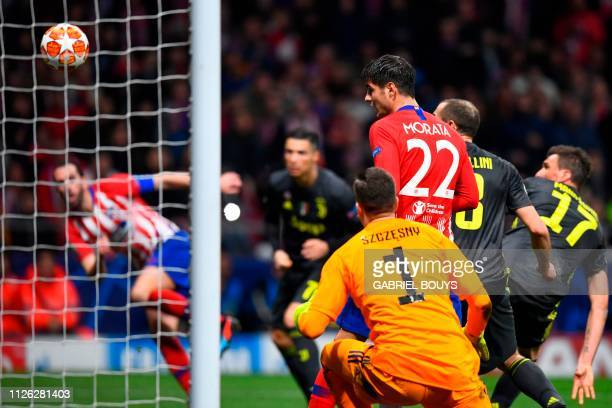 Atletico Madrid's Uruguayan defender Diego Godin scores his team's second goal during the UEFA Champions League round of 16 first leg football match...