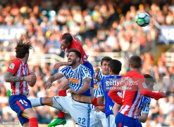 Atletico Madrid's Uruguayan defender Diego Godin vies with Real Sociedad's Spanish defender Raul Rodriguez Navas during the Spanish league football...