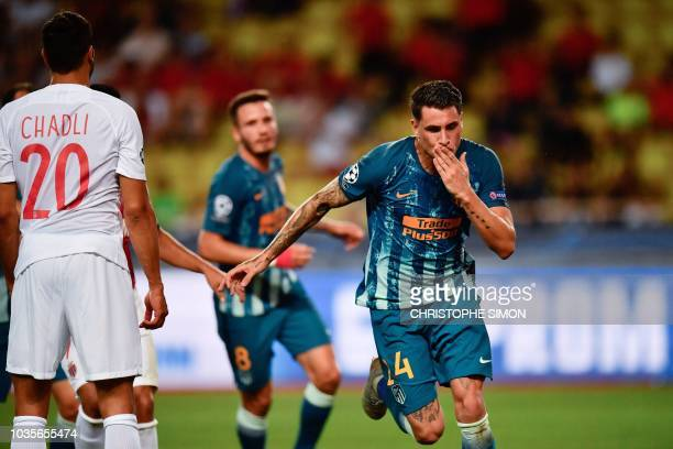 Atletico Madrid's Uruguayan defender Jose Gimenez celebrates after scoring a goal during the UEFA Champions League first round football match between...
