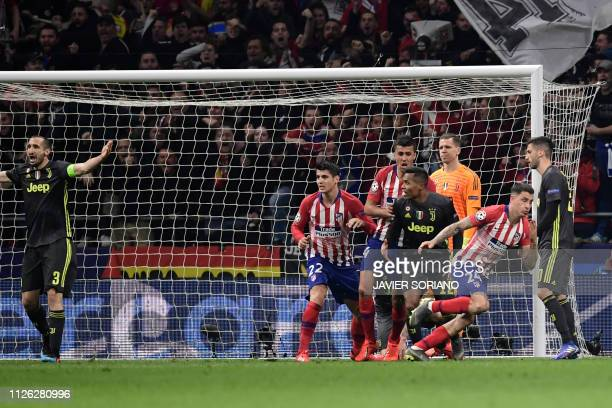 Atletico Madrid's Uruguayan defender Jose Gimenez celebrates after scoring a goal during the UEFA Champions League round of 16 first leg football...